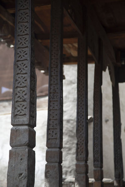 Row of decorated wooden columns in one of the mosques of Ganish | Ganish old town | Pakistan