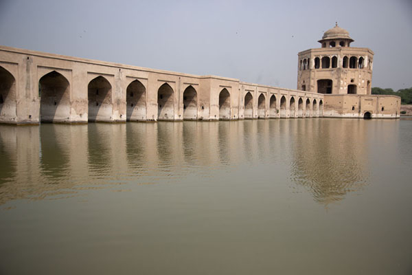 Causeway and pavilion reflected in the pond of Hiran Minar | Hiran Minar | Pakistan