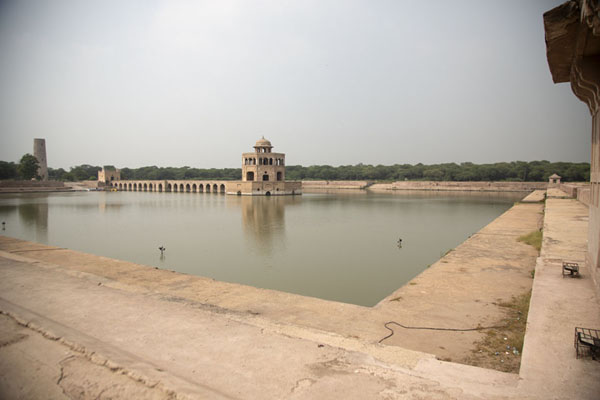 View from the southeast side of the pond with the causeway and pavilion in the middle | Hiran Minar | Pakistan