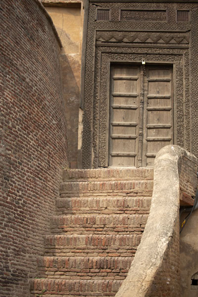 Stairs and carved wooden door next to Elephant Gate | Lahore Fort | Pakistan