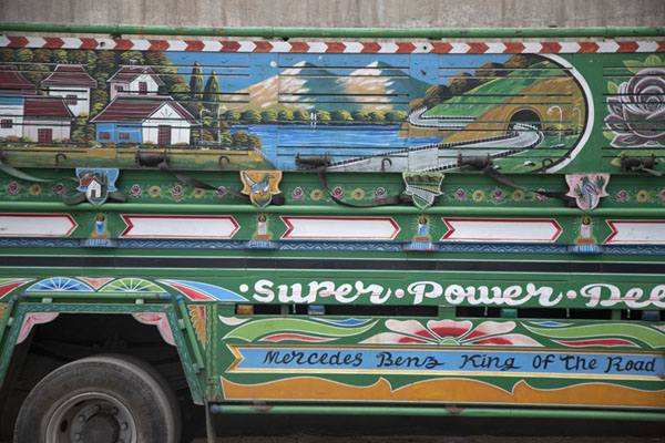 Foto van Landscape painted on the side of a Pakistani truckPaksitan - Pakistan