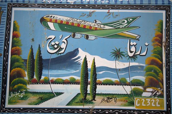 Foto van Panel with a PIA plane flying over a landscape of snowy mountains on the side of a truck - Pakistan - Azië