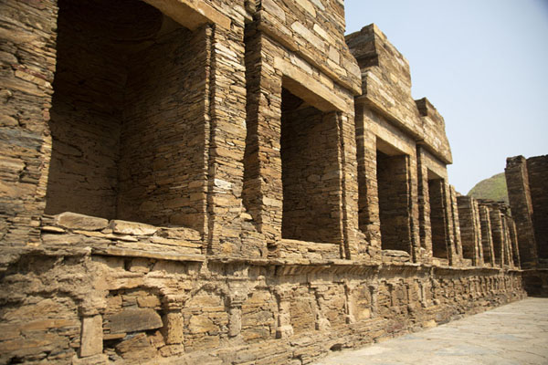 Wall with niches in which Buddha statues once stood on the central stupa court | Takht-i-Bahi | Pakistan