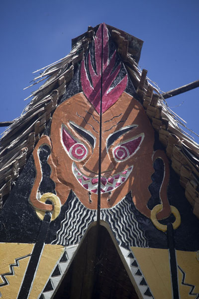 Picture of Face with red eyes painted at the top of the bai of Melekeok - Palau - Oceania