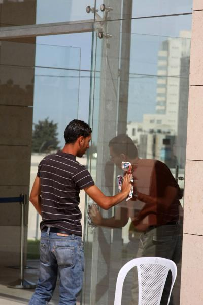 Cleaning the window of the mausoleum | Arafat Mausoleum | Palestinian Territories