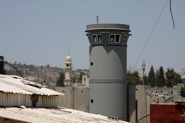 Picture of Israeli Wall (Palestinian Territories): Watchtower, minaret and church have become an integral part of the cityscape around Bethlehem.