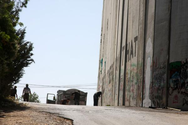 Picture of Israeli Wall (Palestinian Territories): Cleaning around the Israeli Wall