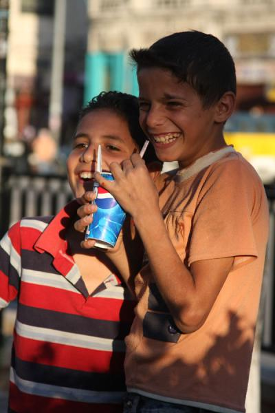 Palestinian boys enjoying a drink in the late afternoon | Palestinians | Palestinian Territories
