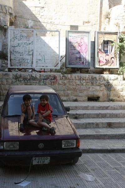 Palestinian boys on a car with political posters | Palestinians | Palestinian Territories
