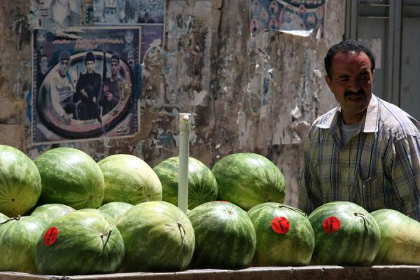 Foto di Palestinian watermelon seller with cart and political postersPalestine - Palestina