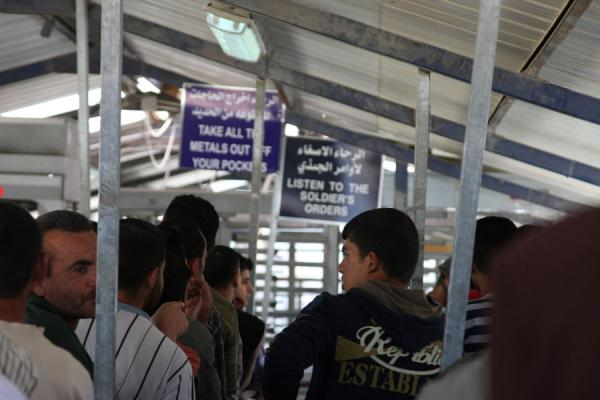 Picture of Palestinians patiently waiting in a queue at a checkpoint near Nablus