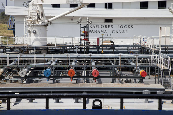 Looking at the main building of the Miraflores locks over one of the giant ships | Miraflores Locks | Panama