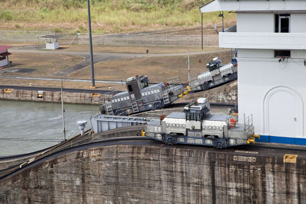 Small locomotives running parallel to the canal | Miraflores Locks | Panama
