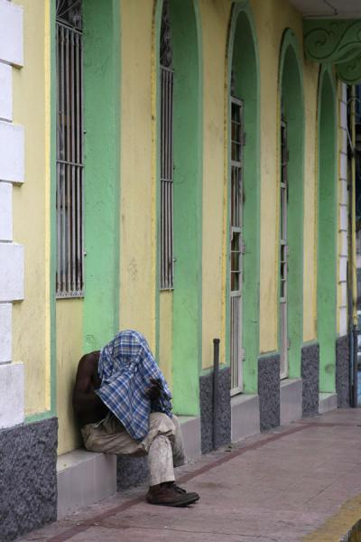 Picture of Panama Old City (Panama): Taking a rest on the sidewalk of the old city of Panama