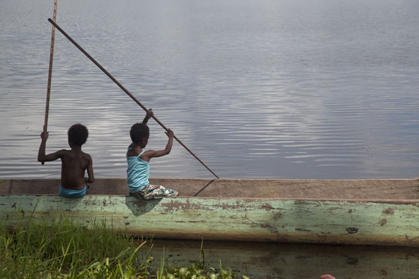 Picture of Angoram (Papua New Guinea): Two young boys fishing at the shore of the lake at Angoram