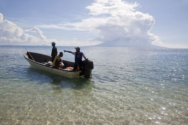 Picture of Betel nut boat on its way back to Angoram with Manam island in the backgroundBetel nut run - Papua New Guinea