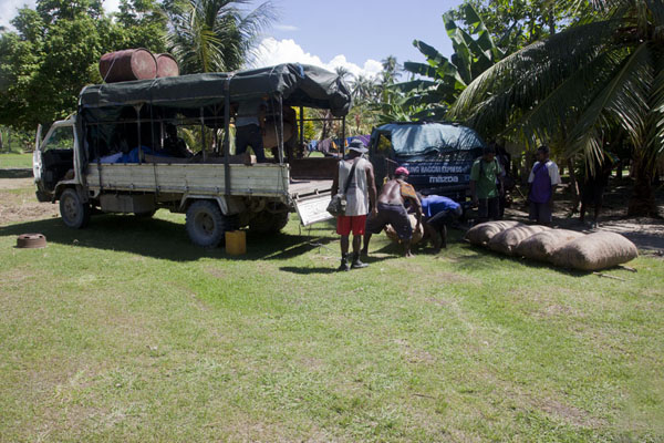 Loading copra on the PMV after most of the betel nut has been sold | Betel nut run Angoram to Madang | Papua New Guinea