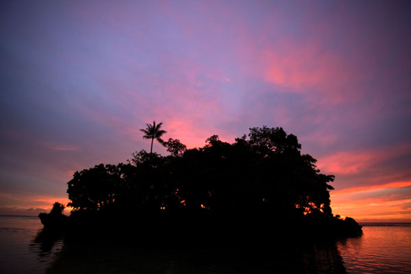 Picture of Sunset over an islet off the beach of KaibolaKaibola - Papua New Guinea
