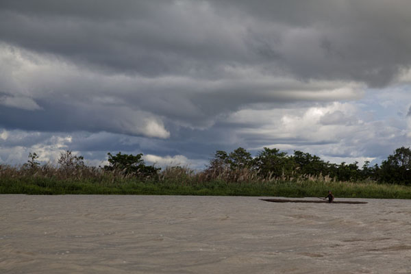 Canoe on the Sepik river under cloudy sky | Keram river | Papua New Guinea