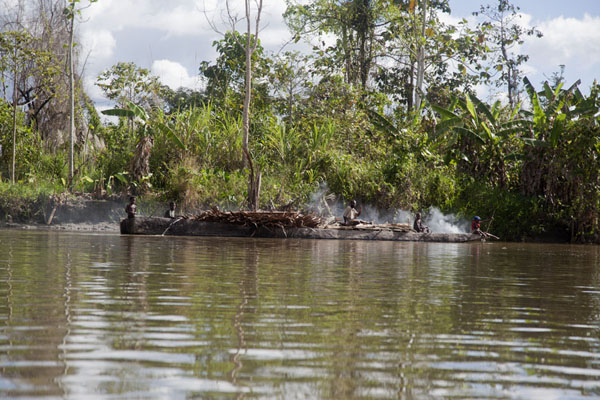 Canoe with smoke to dispel mosquitoes on the Keram river | Keram river | Papua New Guinea