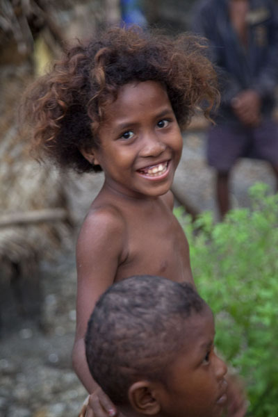 Picture of Papua New Guineans (Papua New Guinea): Laughing girl on Kiriwina island