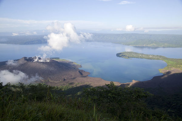 Simpson Harbour with smoking Tavurvur volcano | Rabaul Volcanoes | Papua New Guinea