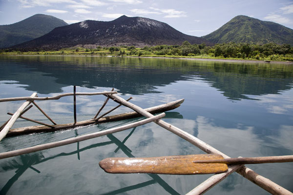 South Daughter, Tavurvur, and Kombiu seen from a traditional canoe | Rabaul Volcanoes | Papua New Guinea