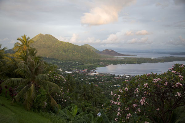 Picture of Late afternoon view over Simpson Harbour with Kombiu, Tavurvur, and South Daughter volcanoes - Papua New Guinea - Oceania