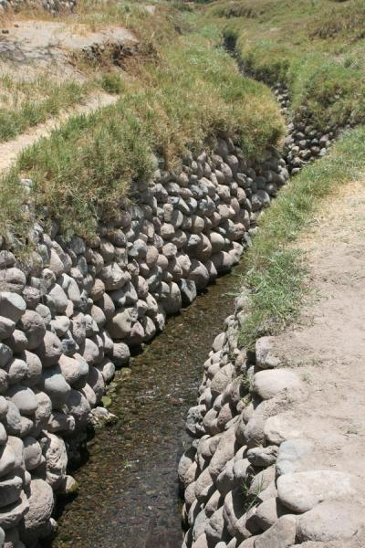 Picture of Cantalloc Aqueducts (Peru): Water running in an S-shape canal at Cantalloc aqueducts