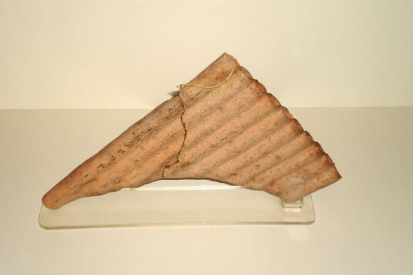 Ancient pan-flute on display in the museum | Huaca Huallamarca | Peru