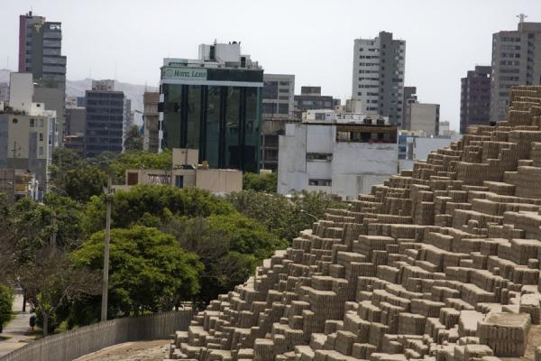 The pyramid of Huaca Pucllana with the modern district of Miraflores in the background | Huaca Pucllana | Peru
