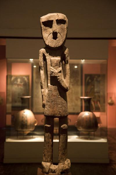 Ruler with feline with more ceramics in the background | Larco Museum | Peru