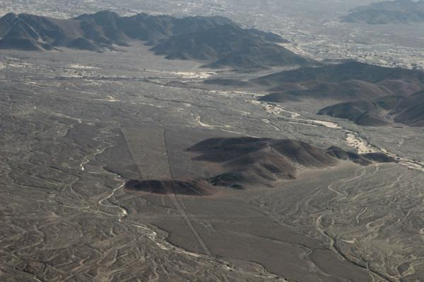 The landscape of the Nazca lines: hills and streams at the end of the pampa | Nazca lines | Peru