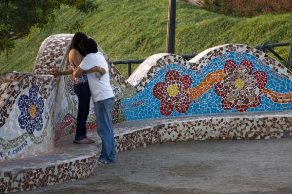 Picture of Parque del Amor (Peru): Colourful Parque del Amor as a background for a kissing couple