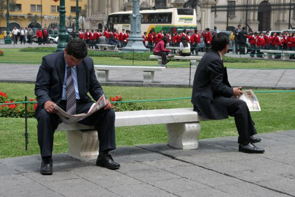 Two men having a break on a bench on the Plaza de Armas | Plaza de Armas | Peru