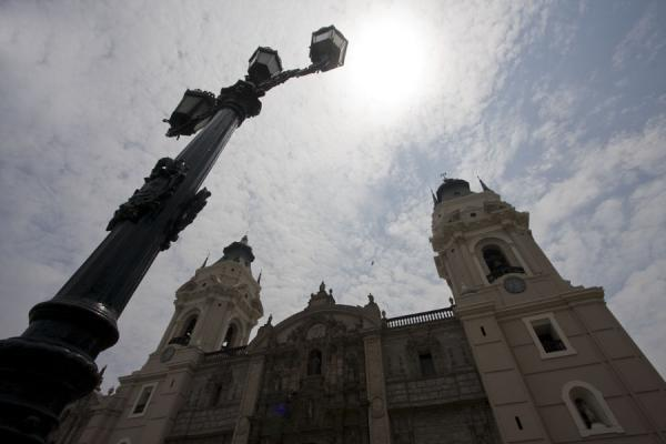Looking up the cathedral with a lantern in the foreground | Plaza de Armas | Peru