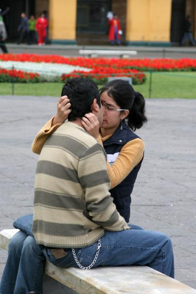 Foto di Young romantic couple on a bench of Plaza de ArmasLima - Peru