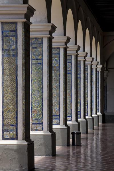 Row of columns with tiles in the convent of Santo Domingo | Santo Domingo church and monastery | Peru