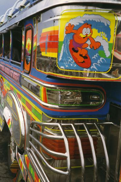 Picture of Jeepney (Philippines): Close-up of jeepney in the Philippines with a surfing Garfield