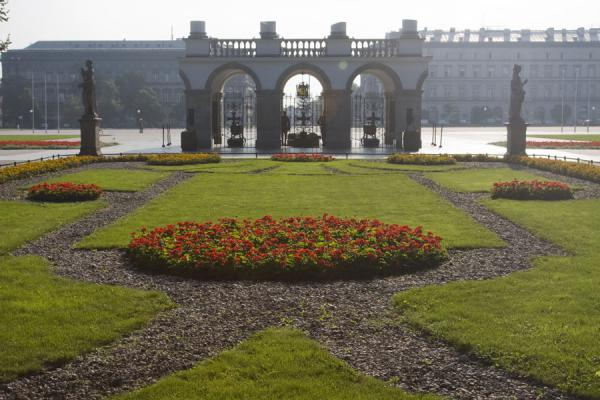 Flower bed with the ruins of the Saxon Palace, now housing Tomb of the Unknown Soldier, in the background | Saxon Garden | Poland