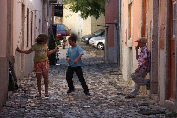 Picture of Young Portuguese kids playing in a small street in AlfamaLisbon - Portugal