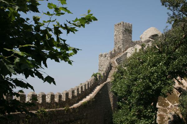 Defensive wall running up a hill | Moorish Castle | Portugal