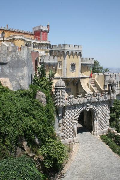 Picture of Palace of Pena (Portugal): Main gate of Palace of Pena and part of the palace in the background