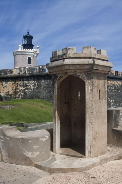 Space for guard with the modern lighthouse in the background | Fort San Felipe del Morro | Puerto Rico