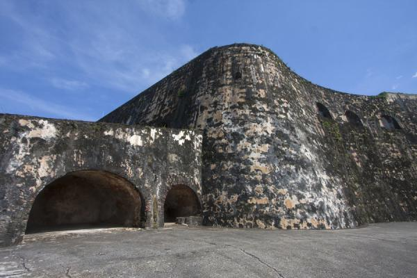 Picture of Enormous wall giving the Fort San Felipe del Morro a solid appearance