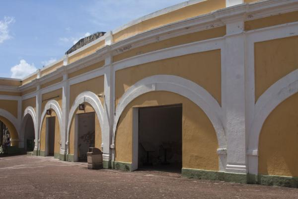 Arches in white on a yellow wall at the central plaza of the fort | Castillo San Felipe del Morro | Puerto Rico