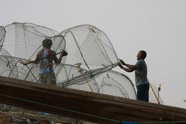Picture of Fishermen arranging the nets on top of their boat