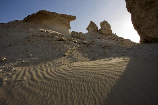 Sand blown around limestone pillars | Bir Zekreet landscape | Qatar
