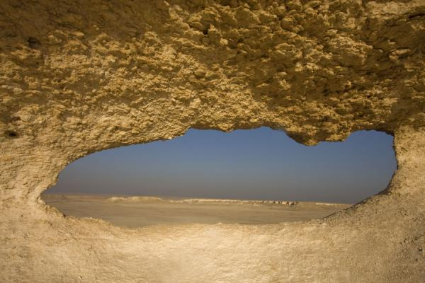View of the landscape of Bir Zekreet through a hole | Bir Zekreet landscape | Qatar