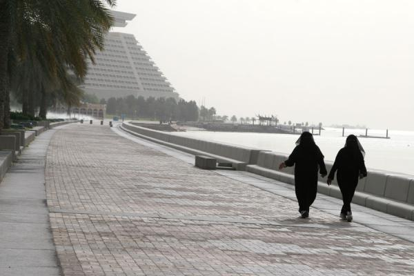 Women in traditional dress walking the Corniche of Doha | Doha Corniche | Qatar